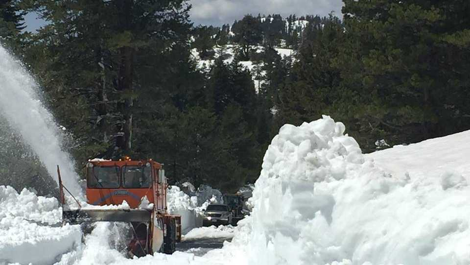 Caltrans crews clear snow on Ebbetts Pass in the Southern Sierra on Thursday, May 25, 2017.