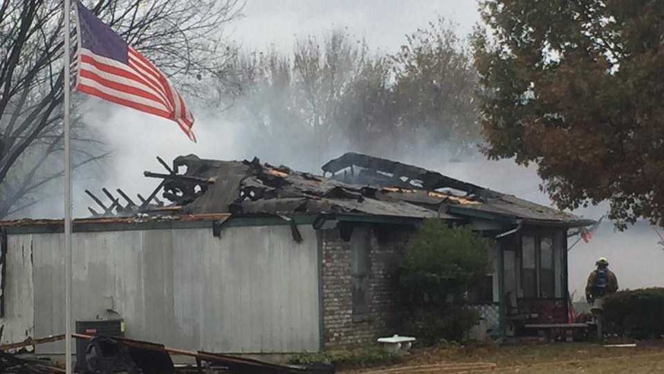 A woman escaped after her house caught fire Tuesday morning in Greenwood.