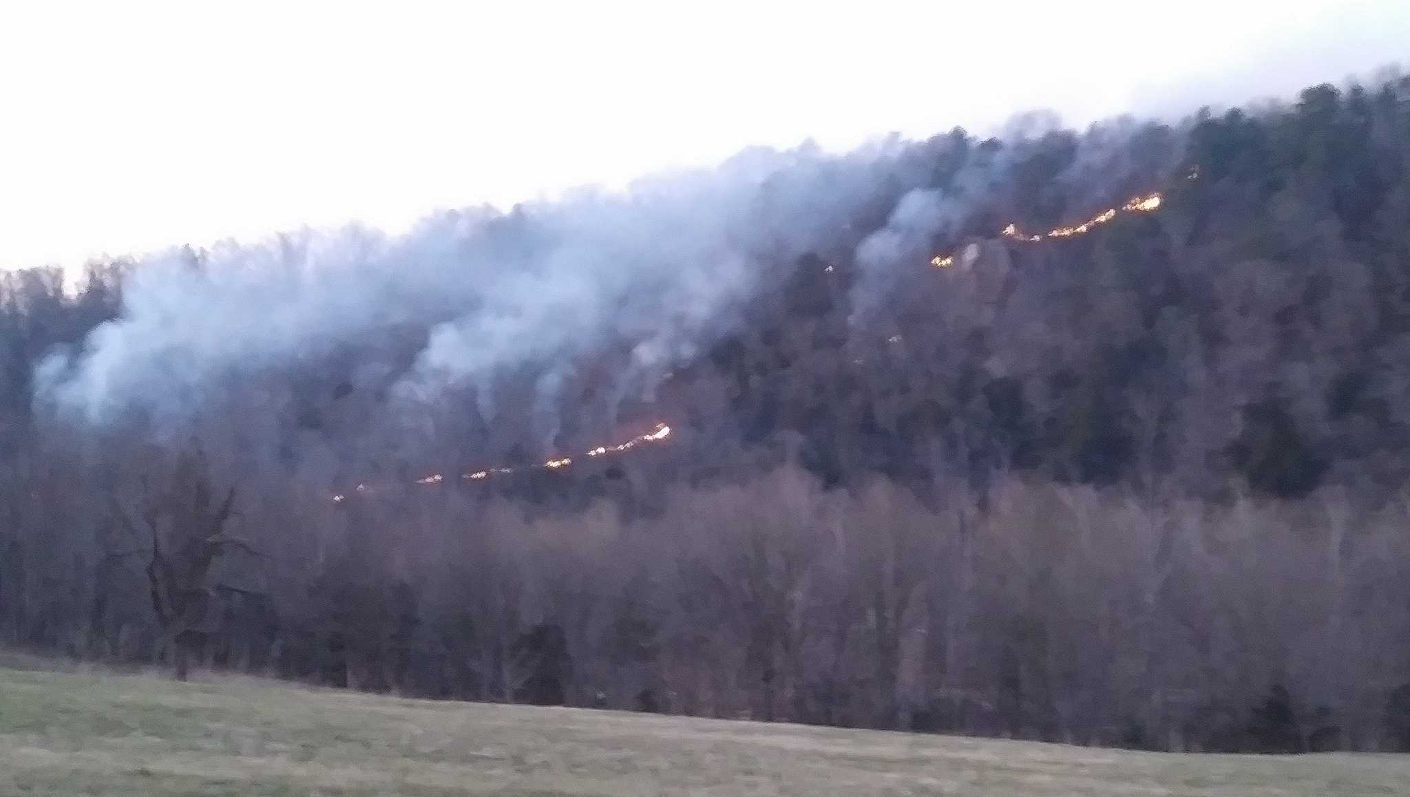Fire crews are battling a large fire near Oak Grove not far fromthe Arkansas-Missouri border in Carroll County.