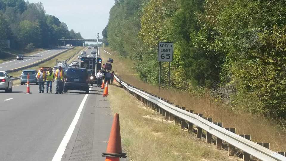 A lane was closed after a body was found along Highway 421 in Forsyth County.