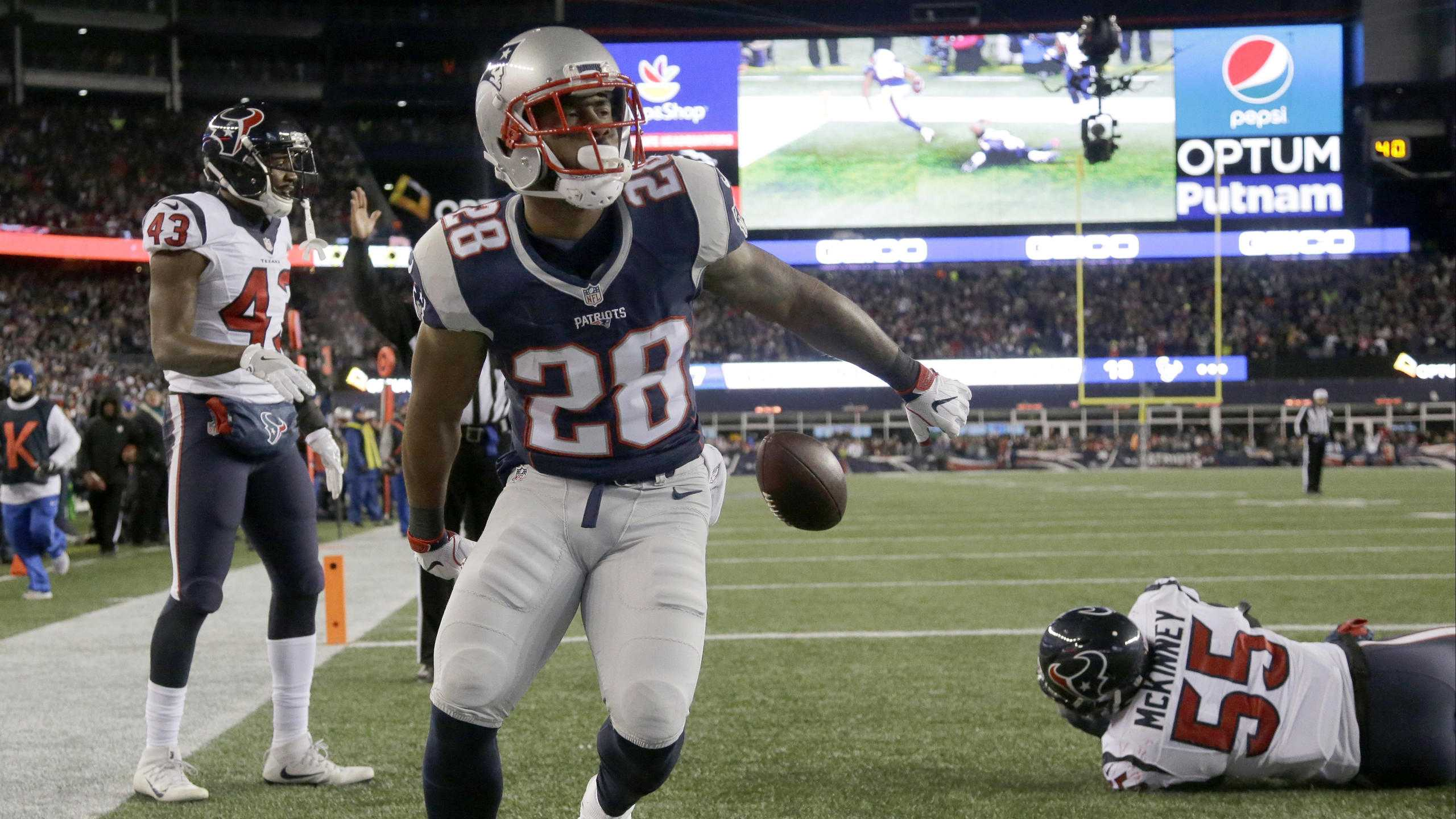 ​New England Patriots running back James White (28) celebrates after scoring a touchdown against the Houston Texans during the second half of an NFL divisional playoff football game, Saturday, Jan. 14, 2017, in Foxborough, Mass.