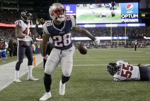 New England Patriots running back James White (28) celebrates after scoring a touchdown against the Houston Texans during the second half of an NFL divisional playoff football game, Saturday, Jan. 14, 2017, in Foxborough, Mass.