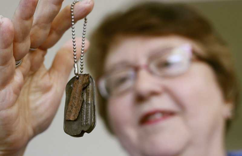 West Bend family reunited with veteran's lost dog tags