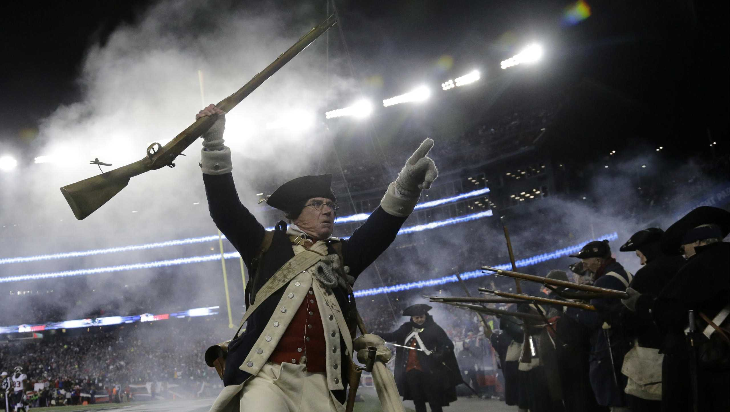 ​A member of the End Zone Militia celebrates a New England Patriots touchdown during the first half of an NFL divisional playoff football game against the Houston Texans, Saturday, Jan. 14, 2017, in Foxborough, Mass.