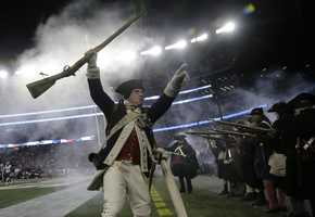 A member of the End Zone Militia celebrates a New England Patriots touchdown during the first half of an NFL divisional playoff football game against the Houston Texans, Saturday, Jan. 14, 2017, in Foxborough, Mass.