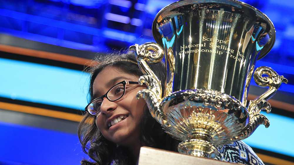 Ananya Vinay, 12, from Fresno, Calif., with her mother, holds her trophy after being declared the winner of the 90th Scripps National Spelling Bee, in Oxon Hill, Md., Thursday, June 1, 2017.