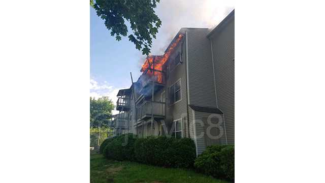 Firefighters are battling a two-alarm apartment fire Tuesday in Abingdon.