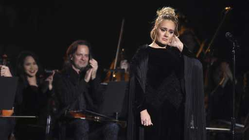 Adele re-starts performance at the Grammys