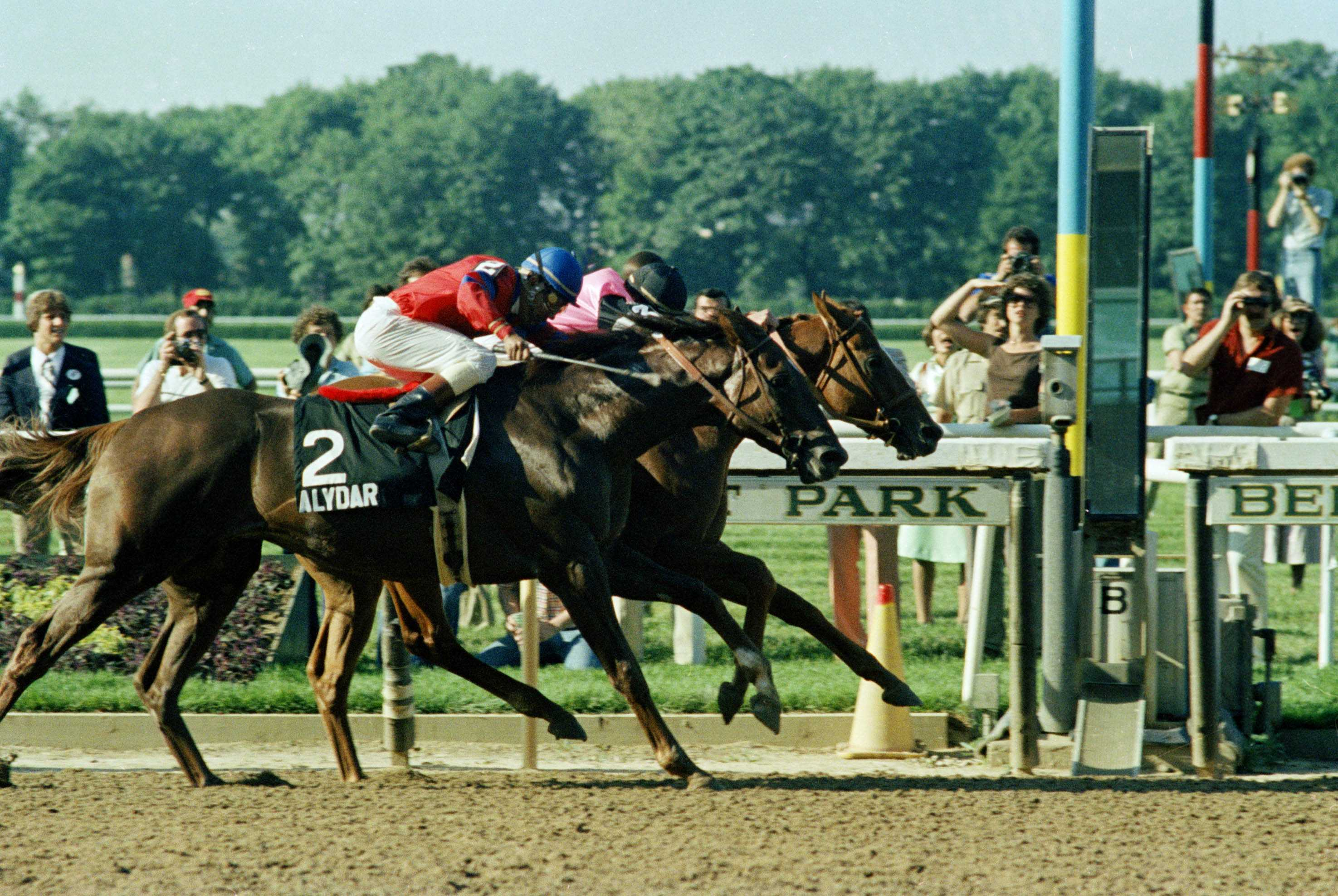 Affirmed, ridden by jockey Steve Cauthen, pulls ahead of Alydar, ridden by Jorge Velasquez, to win Belmont Stakes, June 10, 1978 at Belmont Park in Elmont, N.Y.