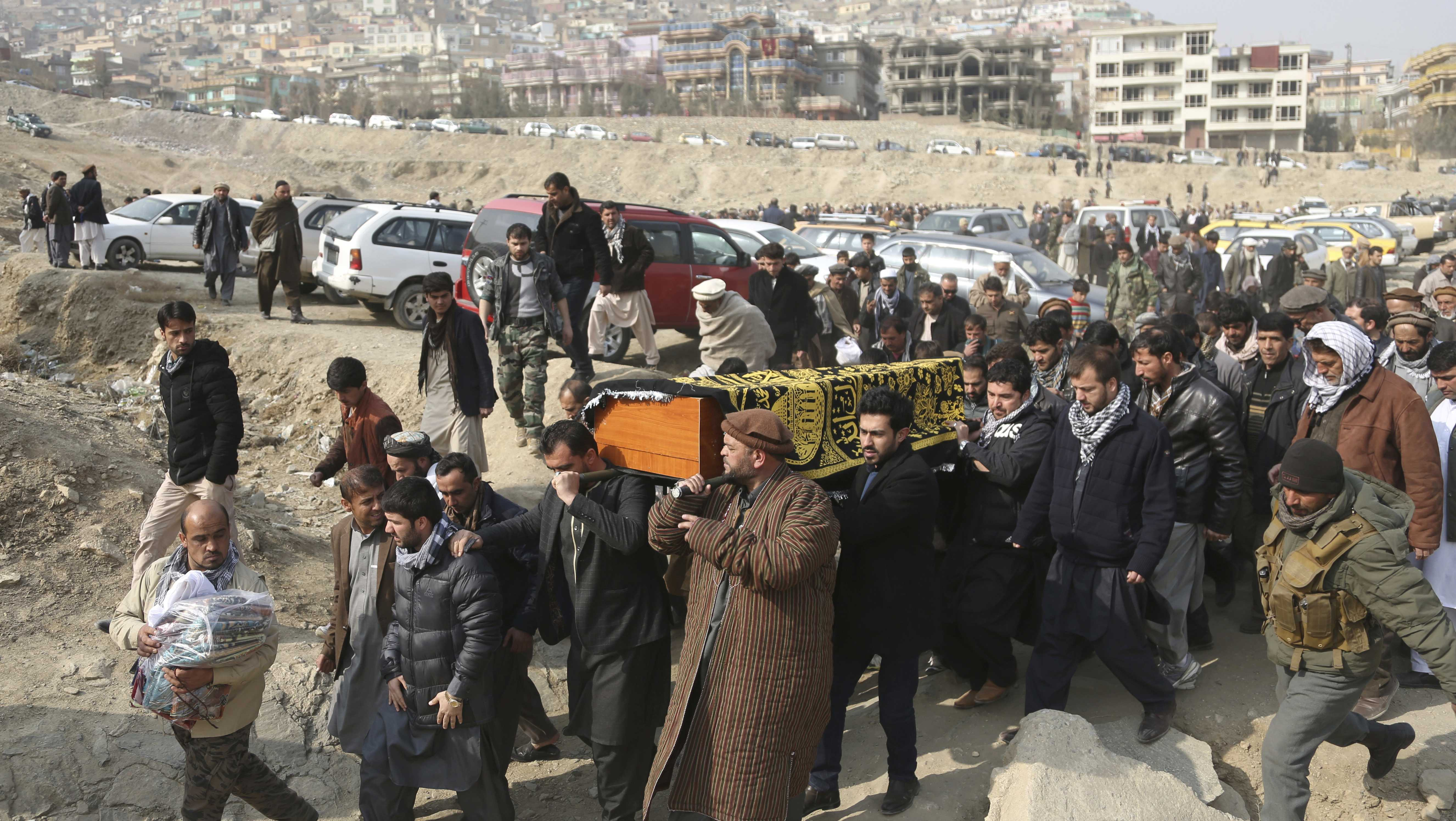 In this Jan. 28, 2018, file photo, men carry the coffin of a relative who died in the Jan. 27 deadly suicide attack in Kabul, Afghanistan.