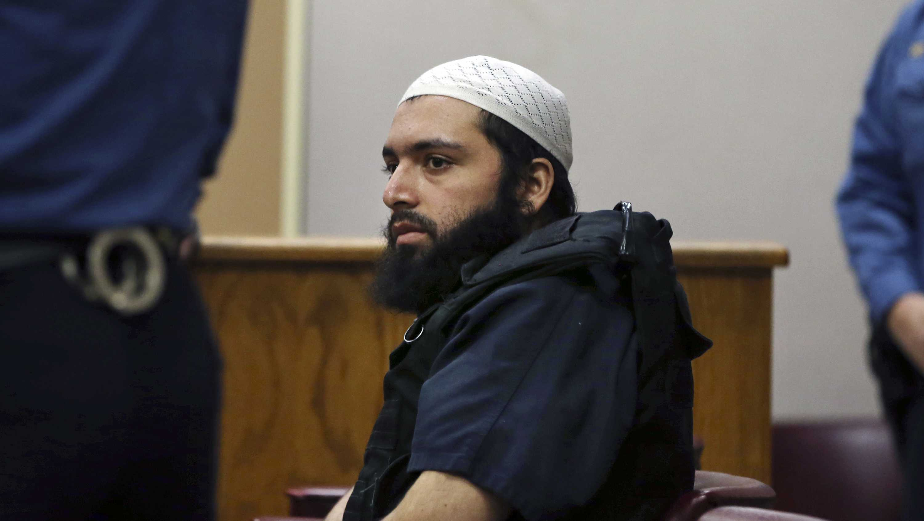 In this Dec. 20, 2016 file photo, Ahmad Khan Rahimi, the man accused of setting off bombs in New Jersey and New York's Chelsea neighborhood in September, sits in court in Elizabeth, N.J. Prosecutors are urging a judge to impose a life sentence on Rahimi. The government made its arguments in papers filed Tuesday, Jan. 16, 2018, in Manhattan federal court.