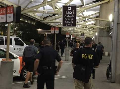 Armed man at Orlando airport 'contained'