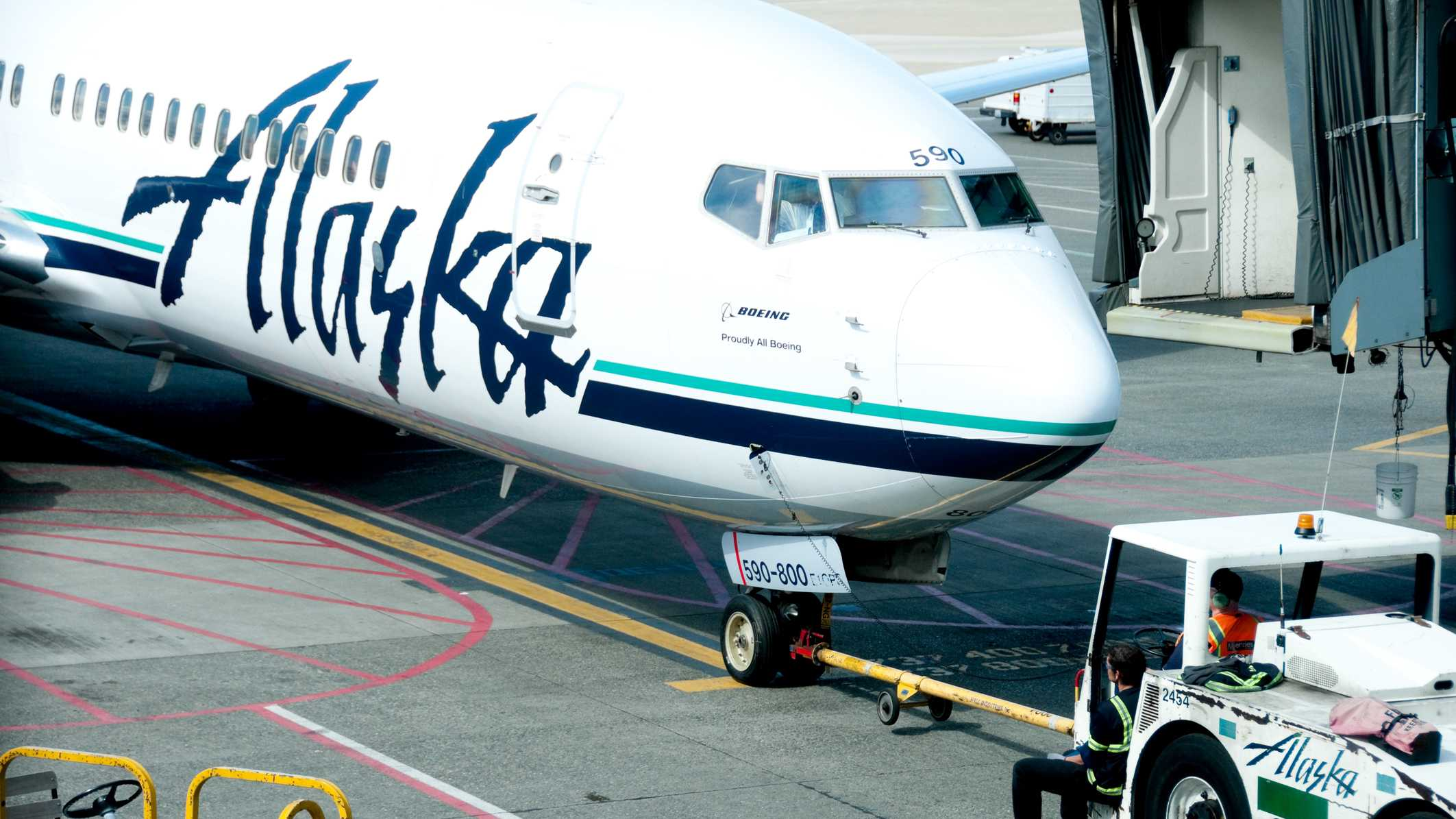 Seattle, USA - April 28, 2012: Alaska Airlines jet at the Seattle Tacoma D Concourse as the ground crew waits for the go ahead to push the aricraft out for departure.