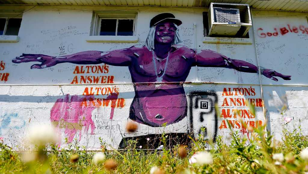 A mural of Alton Sterling is painted on the side of the Triple S Food Mart on May 2, 2017 in Baton Rouge, Louisiana.