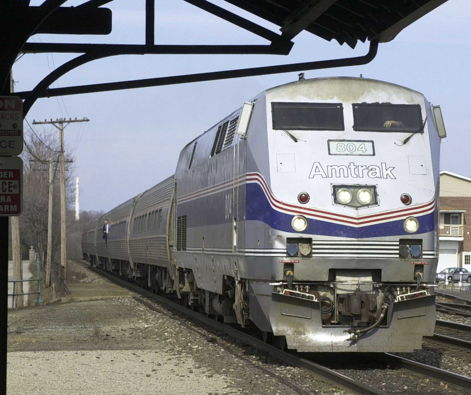 Amtrak conductor shot at suburban Chicago train station