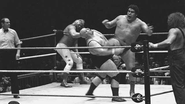 Andre the Giant kicks King Kong Bundy.