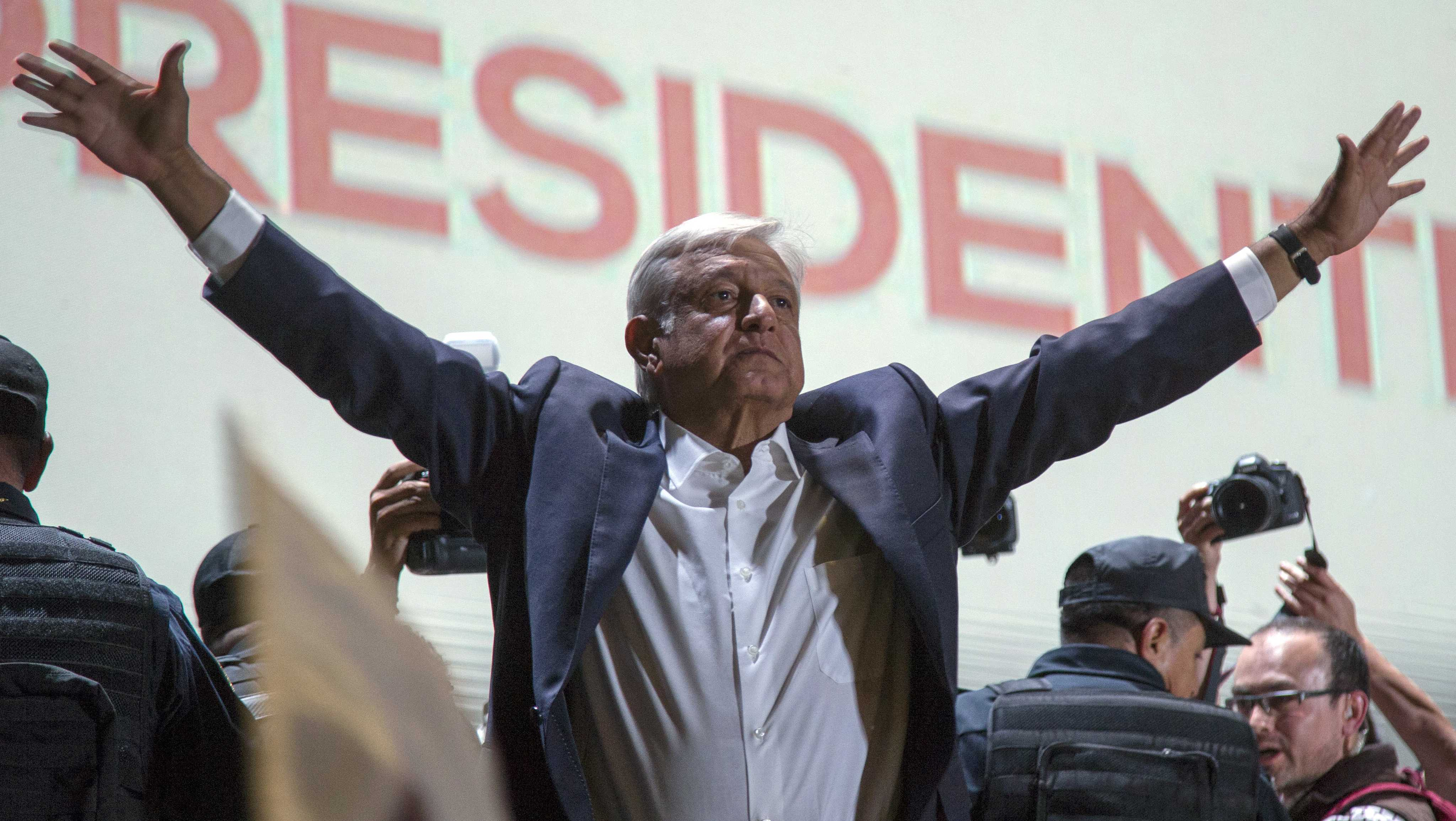 Presidential candidate Andres Manuel Lopez Obrador acknowledges his supporters as he arrives to Mexico City's main square, the Zocalo, Sunday, July 1, 2018. Lopez Obrador has claimed victory in Mexico's presidential election, calling for reconciliation.