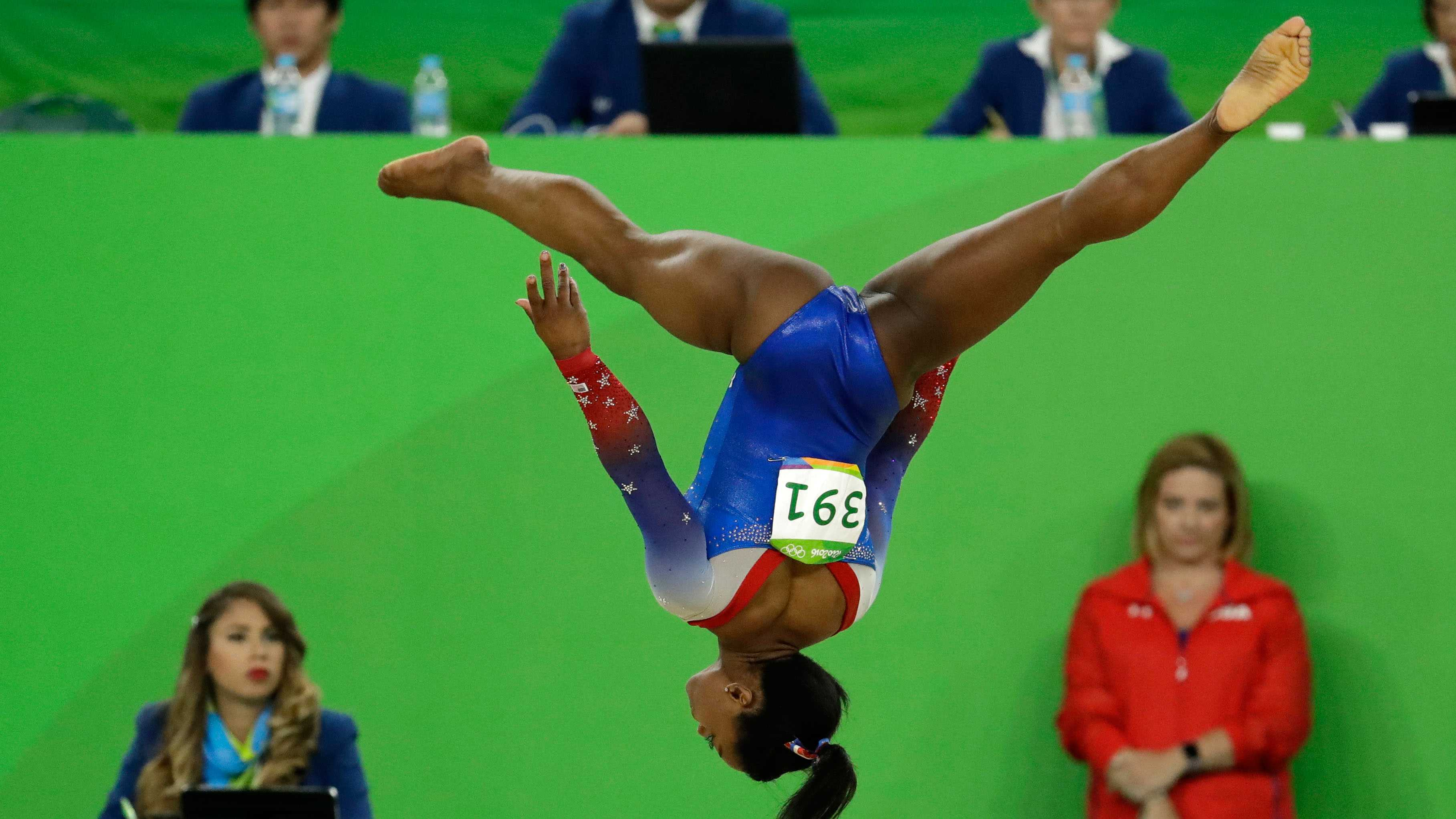 United States' Simone Biles performs on the floor during the artistic gymnastics women's apparatus final.