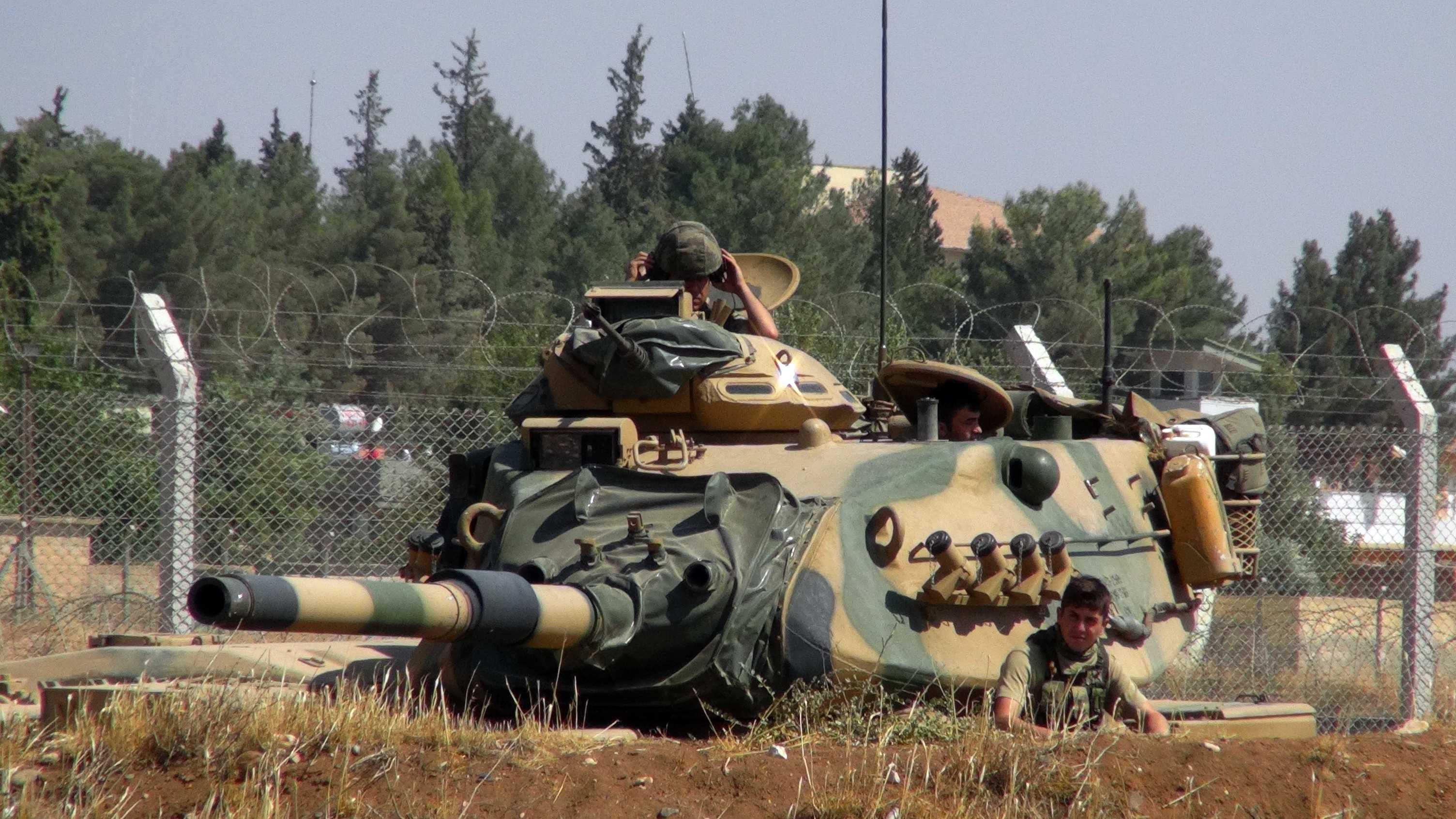 "A Turkish army tank stationed near the Syrian border, in Suruc, Turkey, Saturday, Sept. 3, 2016. Turkey's state-run news agency says Turkish tanks have entered Syria's Cobanbey district northeast of Aleppo in a ""new phase"" of the Euphrates Shield operation. Turkish tanks crossed into Syria Saturday to support Syrian rebels against the Islamic State group, according to the Anadolu news agency."