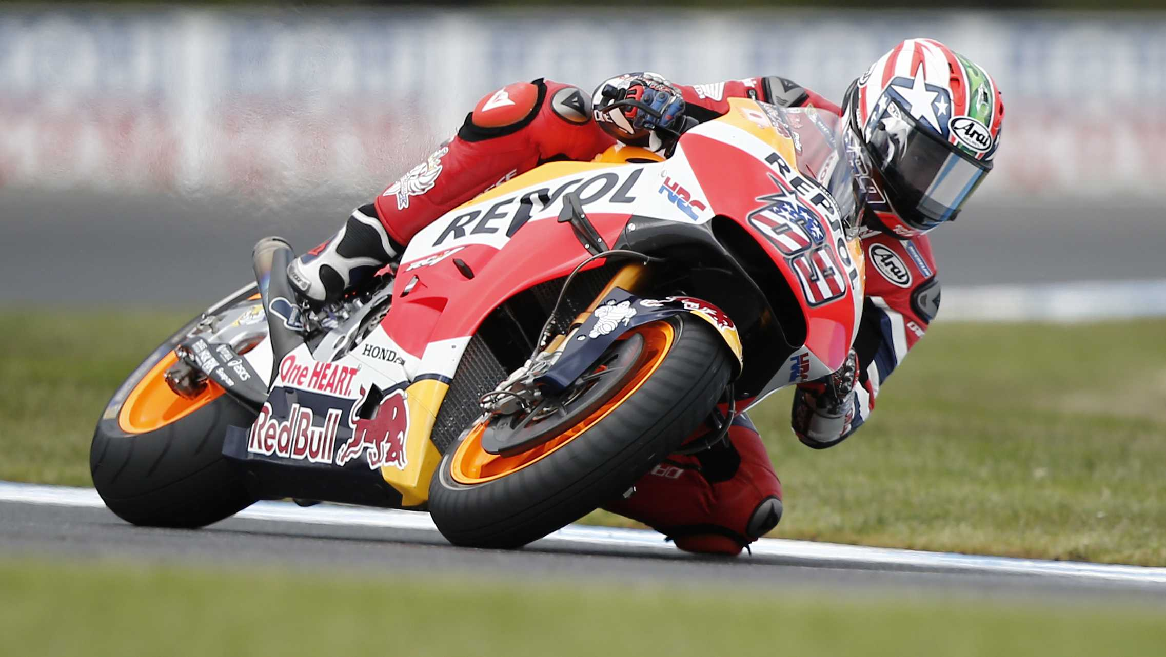 Honda MotoGP rider Nicky Hayden controls his bike on turn 11 during the free practice session number three of the Australian Motorcycle Grand Prix at Phillip Island, Australia, Saturday, Oct. 22, 2016.