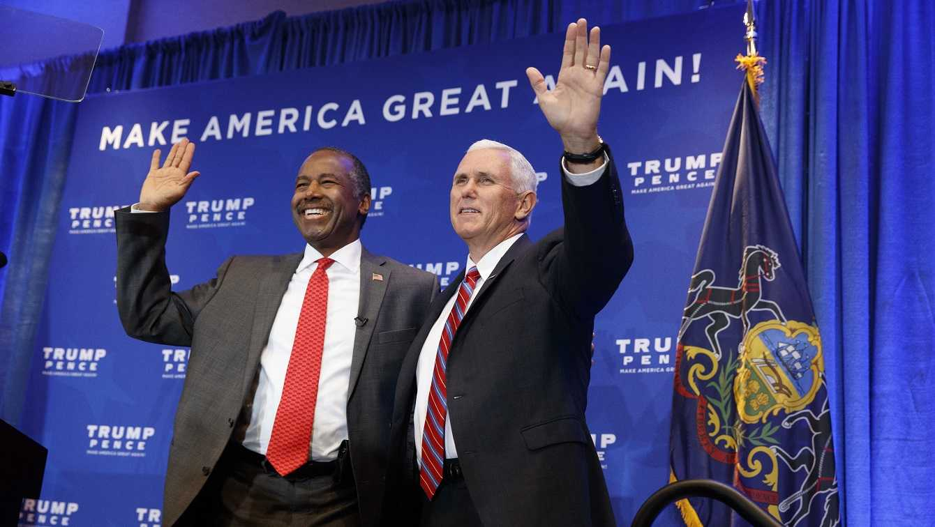 Dr. Ben Carson stands with Republican vice presidential candidate, Indiana Gov. Mike Pence