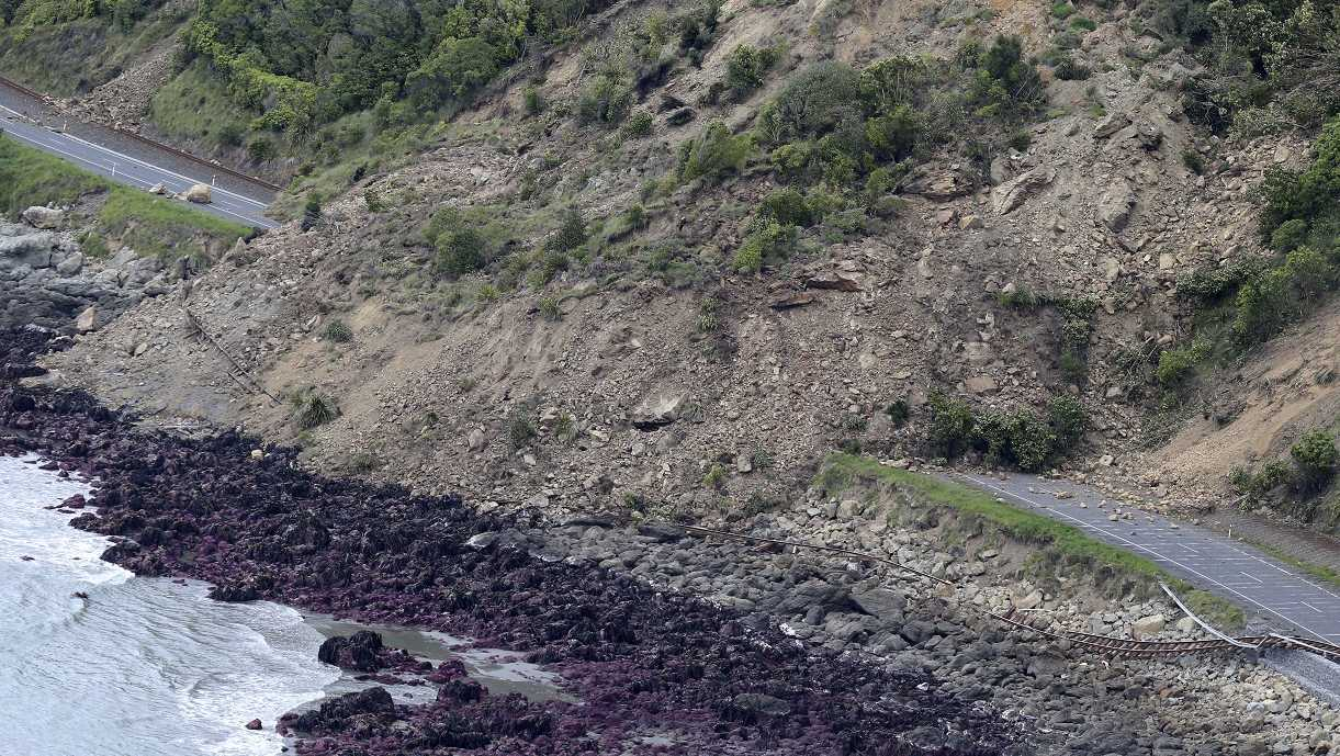 Railway tracks of the main trunk railway line are displaced by a massive landslide that also blocks State Highway One following an earthquake on the coastline, north of Kaikoura, New Zealand Monday, Nov. 14, 2016. A powerful earthquake that rocked New Zealand on Monday triggered landslides and a small tsunami, cracked apart roads and homes and left two people dead, but largely spared the country the devastation it saw five years ago when a deadly earthquake struck the same region.
