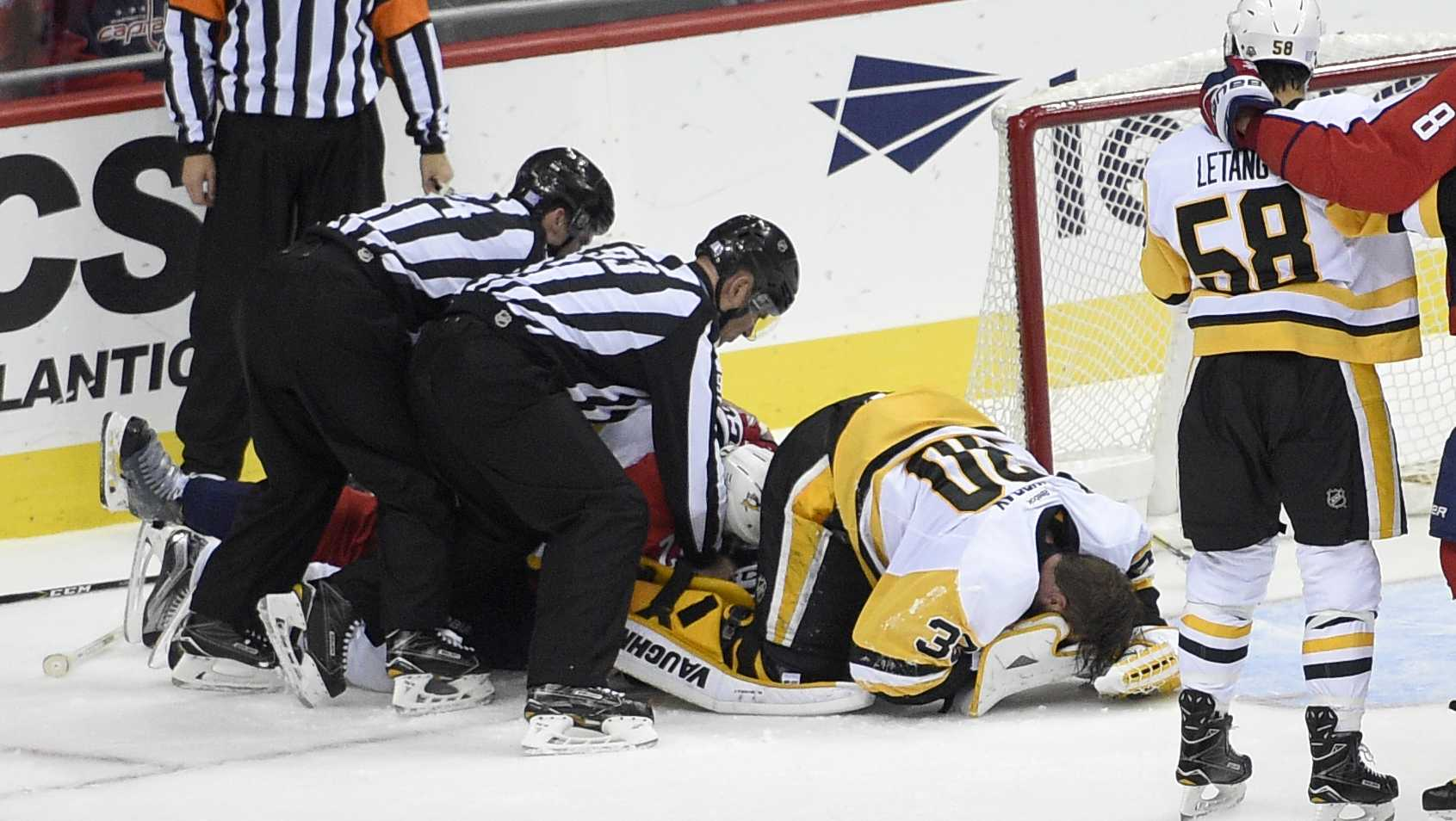 Matt Murray lies on ice after injury