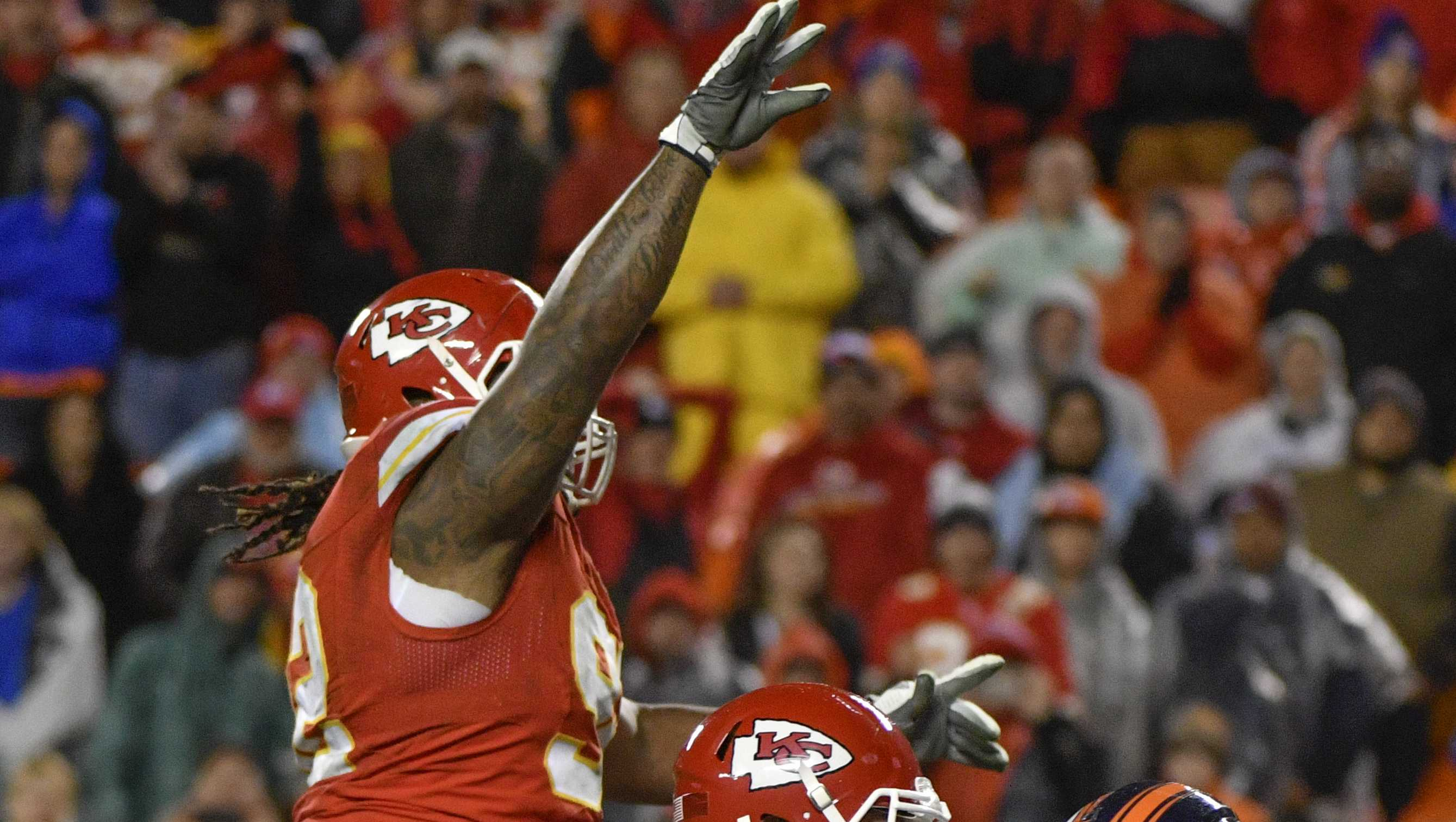 In this Sunday, Dec. 25, 2016 photo, Kansas City Chiefs defensive lineman Dontari Poe, top left, who lined up as quarterback, throws a touchdown pass to tight end Demetrius Harris, as Chiefs offensive lineman Jah Reid (75) blocks Denver Broncos linebacker Von Miller (58) during the second half of an NFL football game Kansas City.