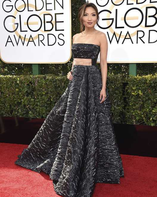 Jeannie Mai arrives at the 74th annual Golden Globe Awards at the Beverly Hilton Hotel on Sunday, Jan. 8, 2017, in Beverly Hills, Calif. (Photo by Jordan Strauss/Invision/AP)