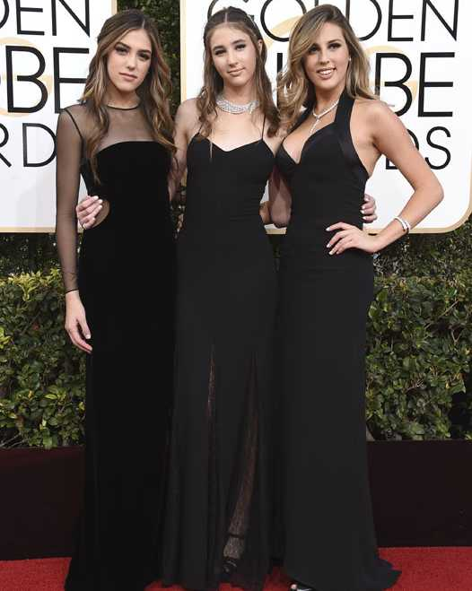 Miss Golden Globes, Sistine Stallone, from left, Scarlet Stallone and Sophia Stallone arrive at the 74th annual Golden Globe Awards at the Beverly Hilton Hotel on Sunday, Jan. 8, 2017, in Beverly Hills, Calif. (Photo by Jordan Strauss/Invision/AP)