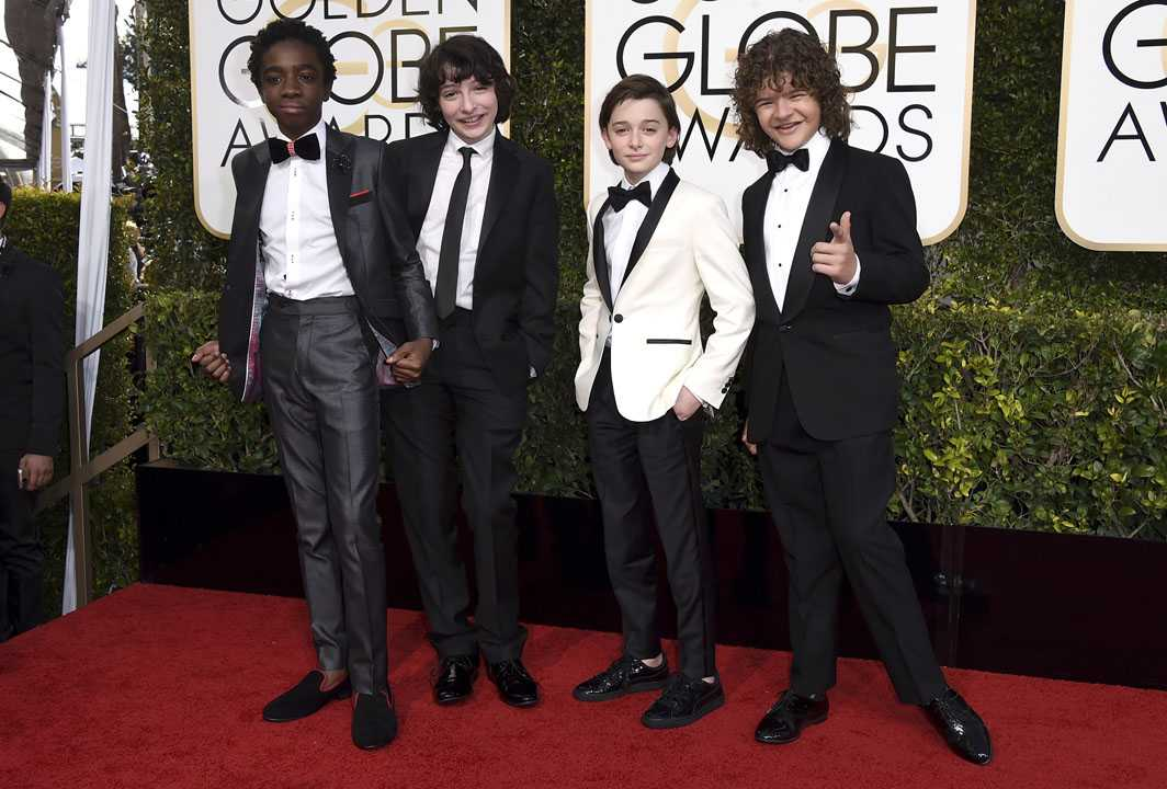 "Caleb McLaughlin, from left, Finn Wolfhard, Noah Schnapp, and Gaten Matarazzo, from ""Stranger Things,"" arrive at the 74th annual Golden Globe Awards at the Beverly Hilton Hotel on Sunday, Jan. 8, 2017, in Beverly Hills, Calif. (Photo by Jordan Strauss/Invision/AP)"
