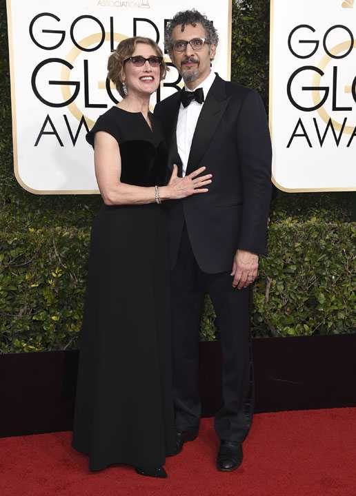 Katherine Borowitz, left, and John Turturro arrive at the 74th annual Golden Globe Awards at the Beverly Hilton Hotel on Sunday, Jan. 8, 2017, in Beverly Hills, Calif. (Photo by Jordan Strauss/Invision/AP)