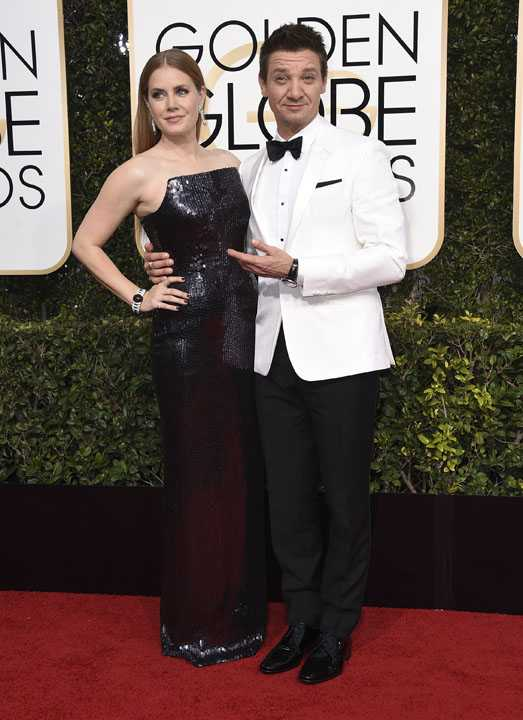 Amy Adams, left, and Jeremy Renner arrive at the 74th annual Golden Globe Awards at the Beverly Hilton Hotel on Sunday, Jan. 8, 2017, in Beverly Hills, Calif. (Photo by Jordan Strauss/Invision/AP)