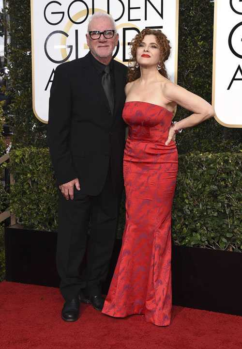 Malcolm McDowell, left, and Bernadette Peters arrive at the 74th annual Golden Globe Awards at the Beverly Hilton Hotel on Sunday, Jan. 8, 2017, in Beverly Hills, Calif. (Photo by Jordan Strauss/Invision/AP)