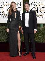 Anna Elisabet Eberstein, left, and Hugh Grant arrive at the 74th annual Golden Globe Awards at the Beverly Hilton Hotel on Sunday, Jan. 8, 2017, in Beverly Hills, Calif. (Photo by Jordan Strauss/Invision/AP)