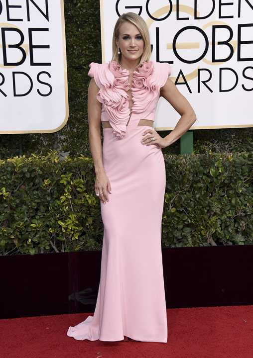 Carrie Underwood arrives at the 74th annual Golden Globe Awards at the Beverly Hilton Hotel on Sunday, Jan. 8, 2017, in Beverly Hills, Calif. (Photo by Jordan Strauss/Invision/AP)