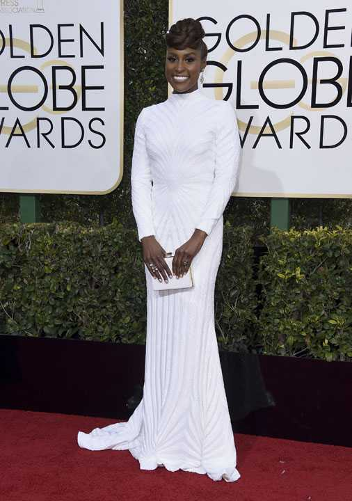 Issa Rae arrives at the 74th annual Golden Globe Awards at the Beverly Hilton Hotel on Sunday, Jan. 8, 2017, in Beverly Hills, Calif. (Photo by Jordan Strauss/Invision/AP)