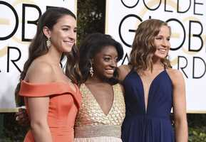 Aly Raisman, from left, Simone Biles and Madison Kocian arrive at the 74th annual Golden Globe Awards at the Beverly Hilton Hotel on Sunday, Jan. 8, 2017, in Beverly Hills, Calif. (Photo by Jordan Strauss/Invision/AP)