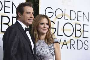 John Travolta, left, and Kelly Preston arrive at the 74th annual Golden Globe Awards at the Beverly Hilton Hotel on Sunday, Jan. 8, 2017, in Beverly Hills, Calif. (Photo by Jordan Strauss/Invision/AP)