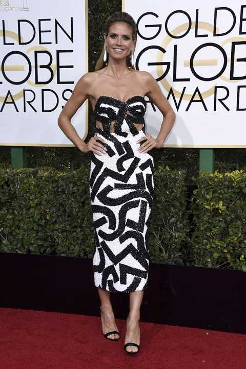 Heidi Klum arrives at the 74th annual Golden Globe Awards at the Beverly Hilton Hotel on Sunday, Jan. 8, 2017, in Beverly Hills, Calif. (Photo by Jordan Strauss/Invision/AP)