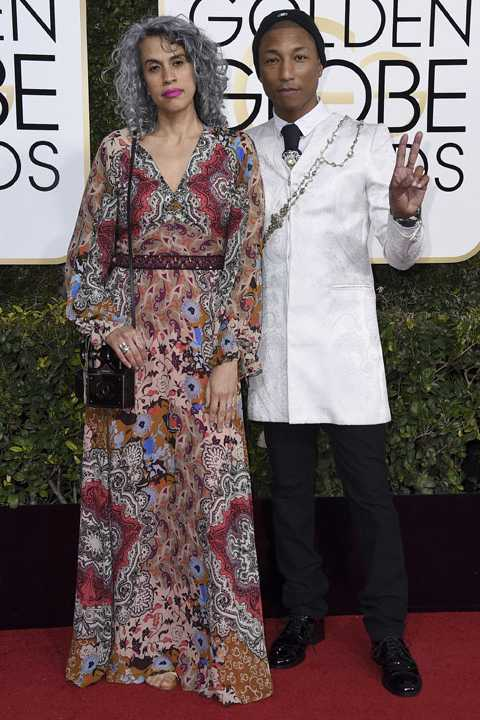Mimi Valdes, left, and Pharrell Williams arrive at the 74th annual Golden Globe Awards at the Beverly Hilton Hotel on Sunday, Jan. 8, 2017, in Beverly Hills, Calif. (Photo by Jordan Strauss/Invision/AP)