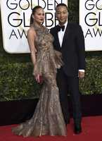 Chrissy Teigen, left, and John Legend arrive at the 74th annual Golden Globe Awards at the Beverly Hilton Hotel on Sunday, Jan. 8, 2017, in Beverly Hills, Calif. (Photo by Jordan Strauss/Invision/AP)