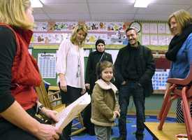 Newly arrived refugee Dania Khatib, 5, tours a classroom