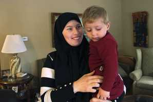 Syrian refugee Ahmed Khatib Mahasen Boshnaq holds her son Mohammed