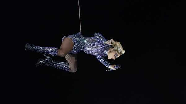 Lady Gaga descends into the stadium during the halftime show