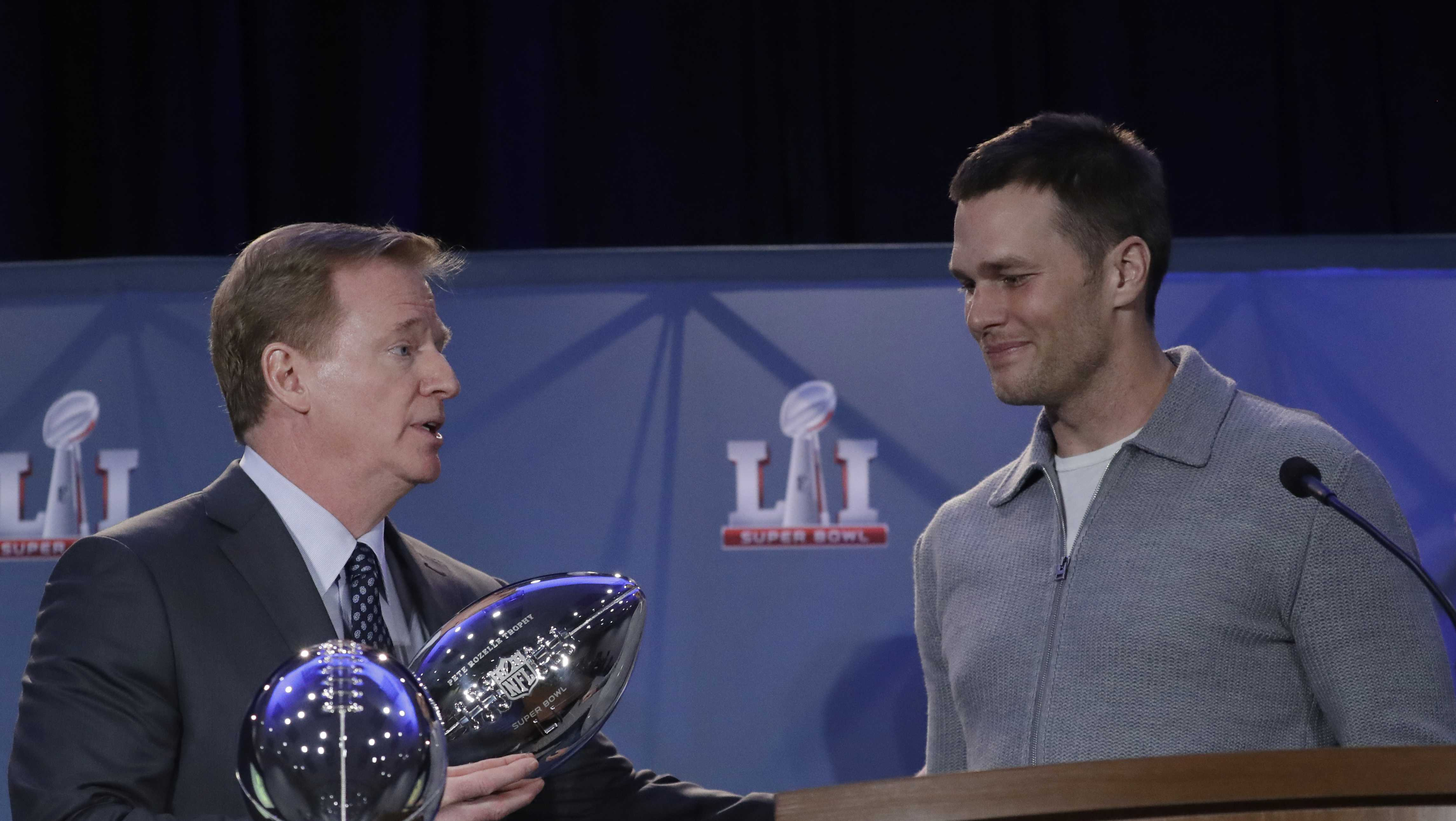 NFL commissioner Roger Goodell hand New England Patriots quarterback Tom Brady the MVP trophy during a news conference after the NFL Super Bowl 51 football game Monday, Feb. 6, 2017, in Houston. Brady was named the MVP of Super Bowl 51.