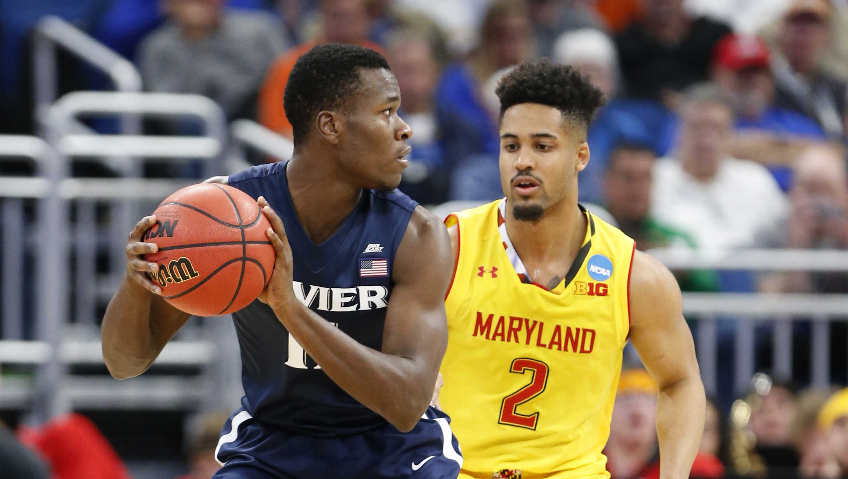 Xavier guard Malcolm Bernard (11) looks for an opening past Maryland guard Melo Trimble (2) during the first half of the first round of the NCAA college basketball tournament, Thursday, March 16, 2017 in Orlando, Fla.