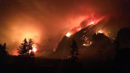 This Sept. 4, 2017, photo provided by Inciweb shows awildfire burning in the Columbia River Gorge east of Portland, Ore. The firealso caused evacuations and sparked blazes across the Columbia River in Washington state