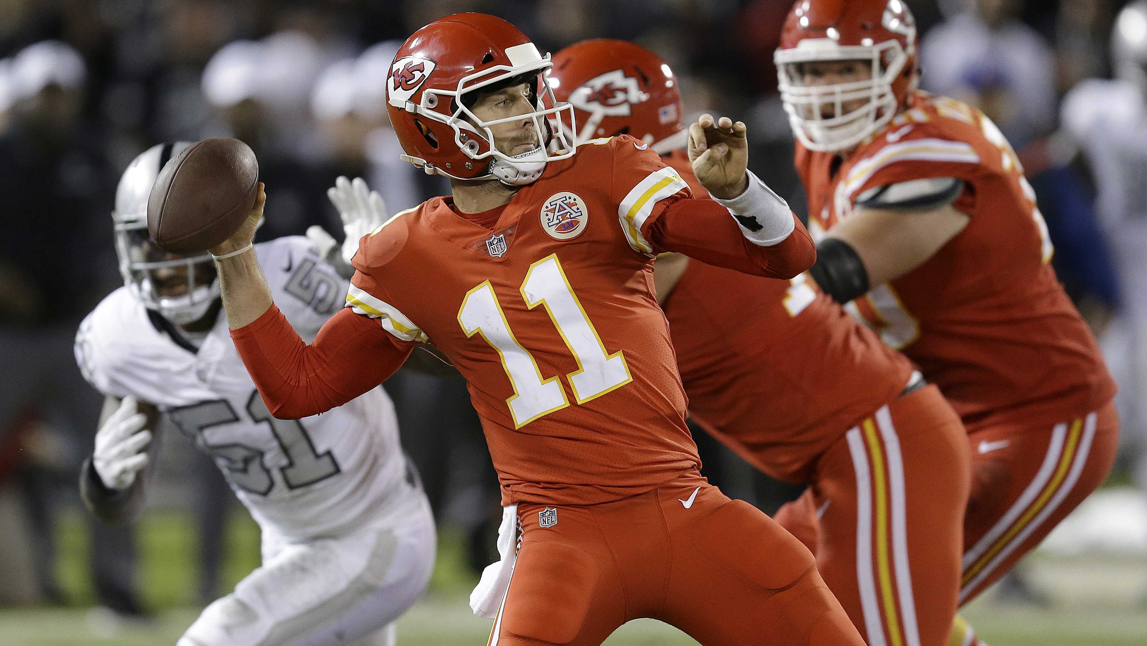 Kansas City Chiefs quarterback Alex Smith (11) passes against the Oakland Raiders during the second half of an NFL football game in Oakland, Calif., Thursday, Oct. 19, 2017. (AP Photo/Ben Margot)