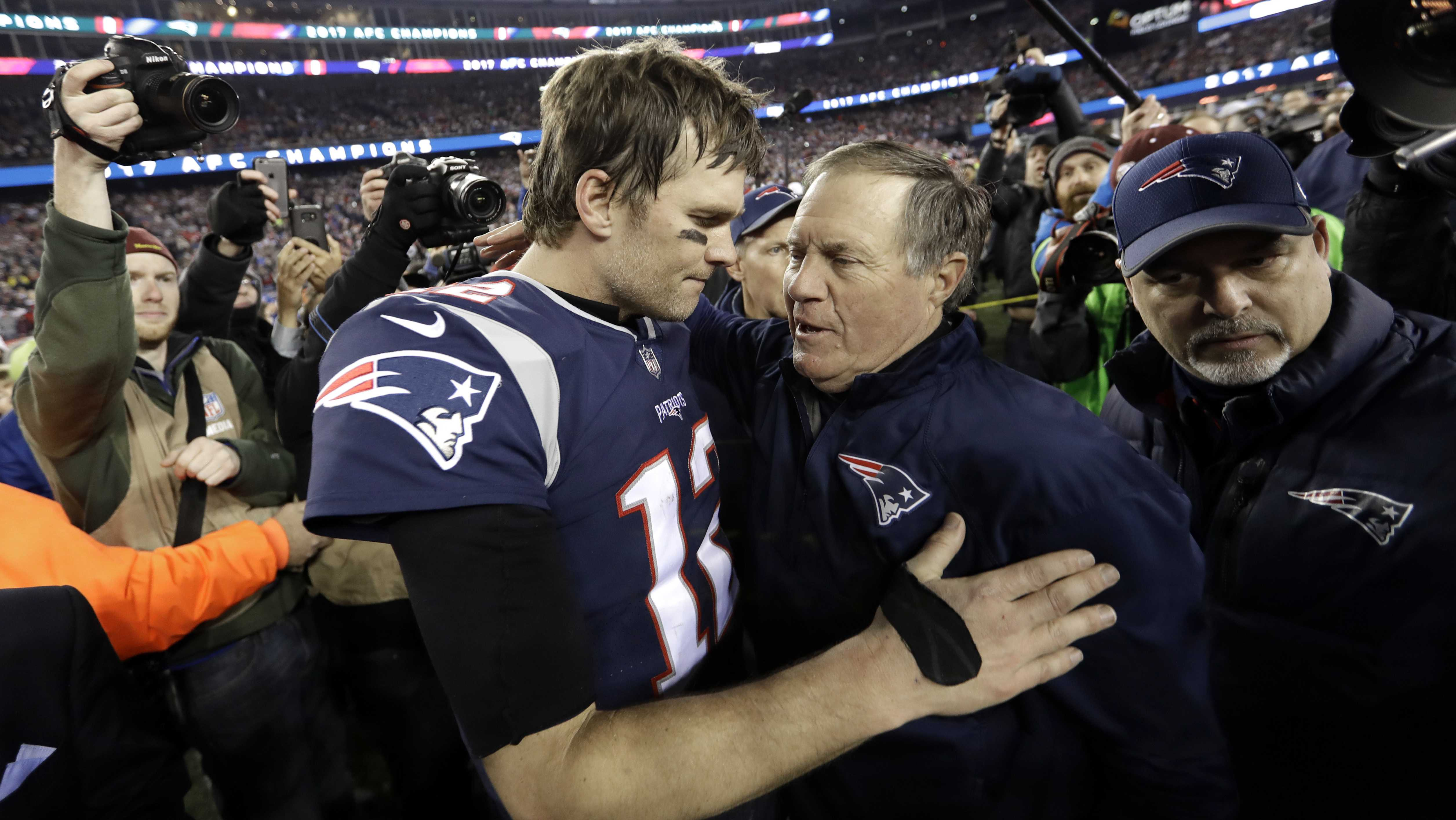New England Patriots quarterback Tom Brady, left, hugs coach Bill Belichick after the AFC championship NFL football game against the Jacksonville Jaguars, Sunday, Jan. 21, 2018, in Foxborough, Mass. The Patriots won 24-20. (AP Photo/David J. Phillip)